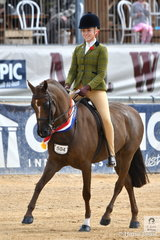 Izabella McIntyre has been close all show and today clamed the best broad sash for Champion Child's Show Hunter Pony with Blane Perkins', 'Mirinda Fortitude'.