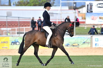 Darci Walsh is pictured aboard her 12.2-14hh Pony Mare winner, 'Wyoming Park Chicago'.