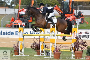 Alison Ostenfield is pictured during the Part 3 jump off riding her, 'Avedon Atom'.