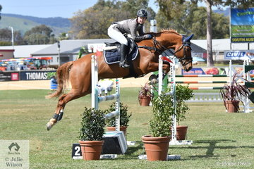 Alexandra Morris is demonstrating a lot of good jump riding qualities as she guides her, 'Starlight Razzle Dazzle' to third place in the Junior jump off class today.