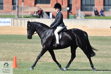 Chelsea Crosby's, 'Whistlejackets Warlord' is pictured during the class for Child's Show Hunter Over 15hh.
