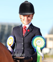 Ella Parish was The DIAMOND DELUXE RUGS Reserve Champion Rider 12 & under 15 years.