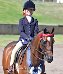 "Annabelle Richardson and ""Hibrie Sugarplum"" won the Child's Small pony Championship event."