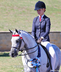 "Emily Mears and ""Greenwood Coco Chanel"" won the Child's Large Pony Championship."