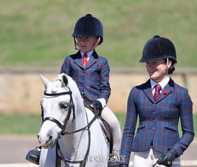 "Jett Skinner riding ""Creswell Hansel"" to win Champion Led Rider under 8 years, led by big sister Mia."