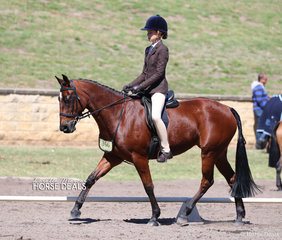 "Pictured working out in the Rider 12-14 years Championship class is Sophie Bennett, riding ""Berragoon Frown""."