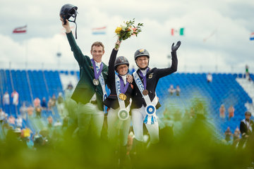 FEI World Equestrian Games... Tryon left to right : Individual Eventing Podium:Silver Padraig McCarthy IRL,Gold Ros Canter GBR, Bronze Ingrid Klimke GER.Photo FEI/Christophe Tani..re