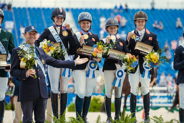 FEI World Equestrian Games... Tryon USA Gold Medalists Great Britain..left to right : Major Richard Waygood, Piggy French, Gemma Tattersall, Ros Canter, Tom McEwen.Photo FEI/Christophe Tani..re
