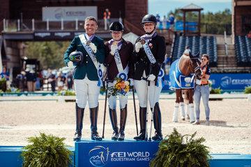 FEI World Equestrian Games... Tryon USA left to right : Rodolpho Riskalla, Sanne Voets, Susanne Jensby Sunesen.Photo FEI/Christophe Tani..re