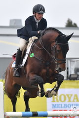 Caroline Price riding her stallion, Calavino placed seventh in the Group C event.