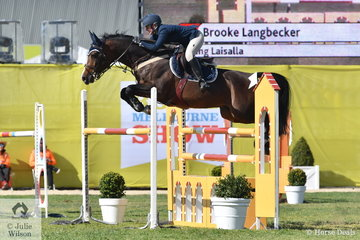 Brooke Langbecker jumped two very good clear rounds aboard her newly imported stallion, Beijing Laisalla, to win the Young Rider contest.
