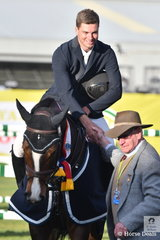 Gracious Tom McDermott was pleased to accept his Prince of Wales Cup award from a former winner, Stan Fear.