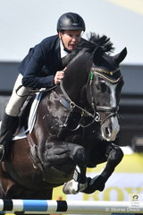 Local rider, Russell Johnstone rode G and S McCann's, imported stallion, Dondersteen in the Group B jumping contest.