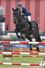 To claim the Champion Group C Jumping Horse title, James Harvey had to win riding his own and Des Russel's imported, 'Castlederg'. And win he did with a super round against the clock.