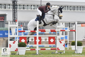 Talented South Australian rider, Nicole Bruggemann is pictured aboard her well named, 'White Wash' during the Mini Prix on the final day of jumping at the 2018 Royal Melbourne Show.