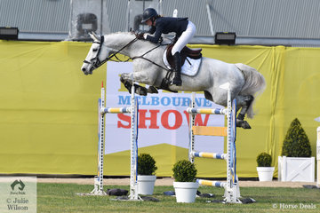Tori Stuckey is pictured aboard her , 'Finch Farm Cab Sav' by Charlemagne Ego Z making a super jump during the Melbourne Royal World Cup Qualifier today.