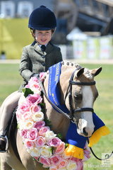 Milla Rose Romeo looks quietly delighted to have won the class for Show Hunter Leading Rein Pony riding Sarah Romeo's delightful, 'Eagle Park Crystal Roulette'.
