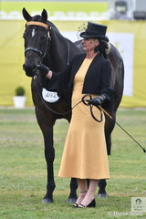 An elegant Katie Ramsay is pictured with her, 'Inafrenzy' by Sharkbite on their way to second place in the Racing Victoria OTT Fashions at the Show competition.