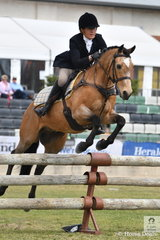 Virginia Wilding is pictured aboard her well performed and eye catching, 'Cafe Cortado' during the Noel Mason Memorial Hunter's Plate.