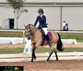 Keeping busy after competing in the eventing, Bella Anthony finds time to also compete Pure Chance in the Secondary 95cm Combined Training at the 2018 Marcus Oldham Interschool Nationals riidng for Queensland.