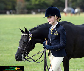 After completing their Led Phase in the Show Horse Primary Charlee Morton-Sharp looks very happy with Secret Valley Rockstar.