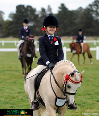 Looking the part and representing Victoria was Erin Bowers and her cute pony Picturesque Prince in the Primary Show Horse.
