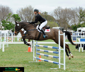 Chloe Thomas and Wilky Wheres Wally compete in the EvA95 for South Australia at the 2018 Marcus Oldham Interschool National Championships held at Werribee.