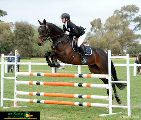 Showing some great style over the fences Georgia Tivendale and Star Allure complete the show jumping phase in the EvA105.