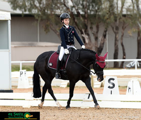 Stretching down in the Primary Novice test was Kennallywood Cunningham with his Queensland rider, Mia Doogue.