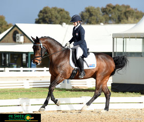 Renee Herboldt and Coldstream Eastern Ridge made the most of the small glimpse of sunshine on the third day of competition as they performed in the Prix St George test at the National Equestrian Centre in Werribee.
