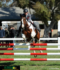 Abigail Lewis and her perfect pinto, Miss Visage compete in the Secondary 1m show jumping at the 2018 Interschool National Championships riding for South Australia.