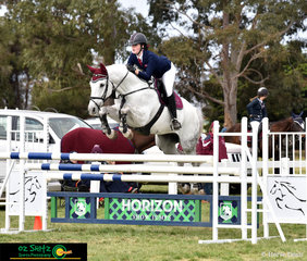 Queensland combinaton, Tara Wilkinson and Harmony Hills Fabio fly over the triple bar in the Secondary 1.20m show jumping competition at the 2018 Marcus Oldham Interschool National Championships.