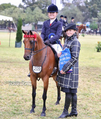 """Judge Charlie Hunt with her winner of the Child's Pony ne 12.2hh, rider under 12 yrs """"Silkwood Fairy Wings"""" ridden by Sascha Parker-Eade."""