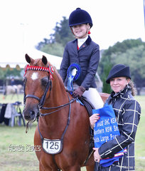 """Indiana Hogan & """"Whitmere Hello Darling"""" won the Child's Pony over 12.2h ne 14h, rider under 12 yrs Grand National qualifying class, pictured with judge Charlie Hunt."""