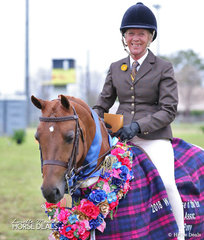 """Sandra Henry and """"Divine Romance""""  won the flowers in The TABLELANDS SHOW HORSE & PONY ASSOCIATION INC. Large Show Hunter Pony of the Year event."""