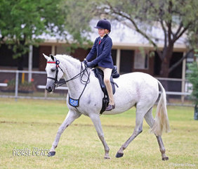 """Working out in The SYDNEY REGIONAL HACK EXHIBITORS ASSOCIATION Rider 9 & under 12 years event is Mark Jones from Gunnedah, riding """"Bamborough Etchings""""."""