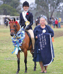 """The CENTRAL COAST & LOWER HUNTER HACK ASSOCIATION INC. Champion Small Saddle Pony of the Year """"Royal Oak Figurine"""" and Elizabeth Daly, pictured with one of the three judges Catherine Gale."""