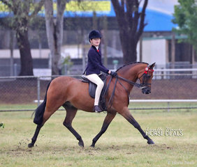 """The Kearney & Lyons nomination """"Highcroft Makin Music""""  working out in The SJM EQUINE Large Saddle Pony of the Year event. Earlier in the Show they were the Winners of the Child's Pony over 12.2 not exceeding 14hh, rider 12 yrs & under 17 yrs class."""