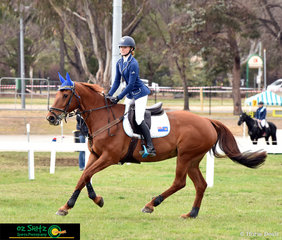 Aria Baker and Emcee Flamboyance enjoy their victory lap after winning the second round of the NSW Children's Championship Title Series at the 2018 NSW State Show Jumping Championships.