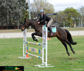 In a class of 76 riders, Bella Griffen riding Sir King Charles take out first place in the 1m Super Phase on the first day of competition at the NSW State Show Jumping Championships.