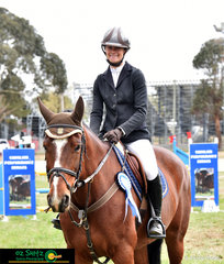 Smiles all round for Chloe Mannell after receiving second place in a large competiive field at the NSW State Showjumping Championships Open 1.10m class.