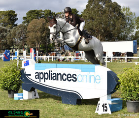 Amelia Douglass and Upperclass Z clearing the wall with ease on the last of compeition in the Juniors final at the NSW Showjumping State Titles.