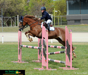 Emily Lang-McMahon riding KS Rosie soar over the final jump in the first round of the NSW Children's Title on the second day of competition in the Barastoc Arena.