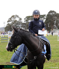 Winners are grinners! Elkee Lang-McMahon and KS Pepper take out the win in the first round of the Children's Title Series at the NSW State Show Jumping Titles.