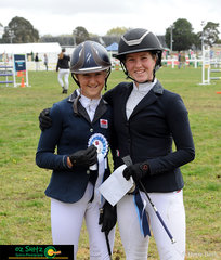 Emily Quodling and Mikaela MacNamara smile together during the presentation for the Open 90cm A2.