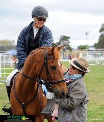Barastoc Arena judge, Anne Sheean awards Karen Higgins and Magnum Starblaze their rosette after the Open 90cm Super Two Phase on the final day of competition of the NSW Show Jumping Championships.