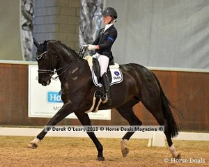 Divina ridden by Kaitlin Martin in the FEI Junior Individual CDI-J scored 63.873%
