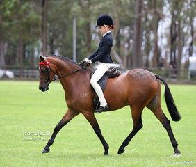 "Champion Large Pony and Champion Ridden Riding Pony ""Emyella Pure Heaven"" and Elizabeth Taylor."