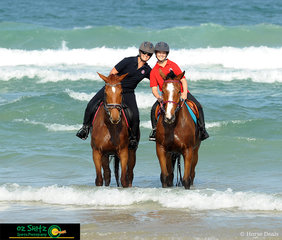 Family day out was the theme, this time mother (Nicole) and daughter (Alise) have a hug in the surf with thier horses.