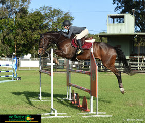 Elisha Hodgson and Kyldar Judgement soar over an oxer in the 1.20m class at Cabarita Beach Spring Show Jumping Classic.